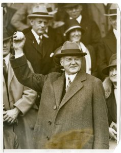 President Hoover throwing out the first ball of the season in a game between the Washington Senators and the Boston Red Socks. 04/14/1930