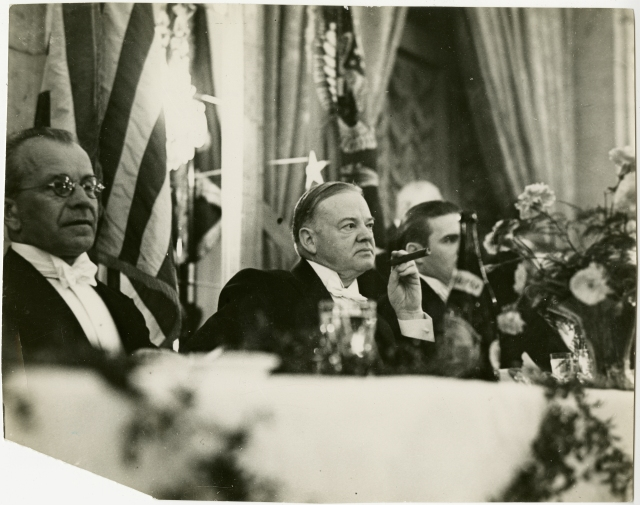 Former president Hoover attending a dinner in Prague, March 4, 1938.