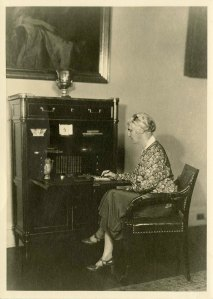 "ou Henry Hoover sitting at the ""Monroe Desk"" -  that was reproduced for the White House collection. ca 1931"